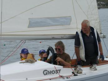 Grace, Ebony and Albert Oldfield prepare for a sail with Johnno on Ghost on Discover Sailing Day
