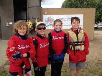 Charlie Broomhall, Taj Duff, Ella Curtis-Webster and Curtis Wilmot attending the Junior School Sailing Carnival on Albert Park Lake