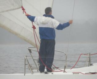 A foggy Tuesday Twilight with the Rio de Janeiro statue manning the headsail on Saracen