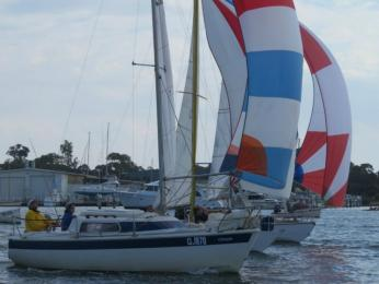 Nose to nosing down the Straits in the Regatta