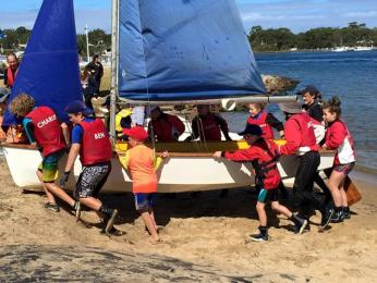 All the kids help bring in the last boat after the juniors' Easter Appeal circumnavigation
